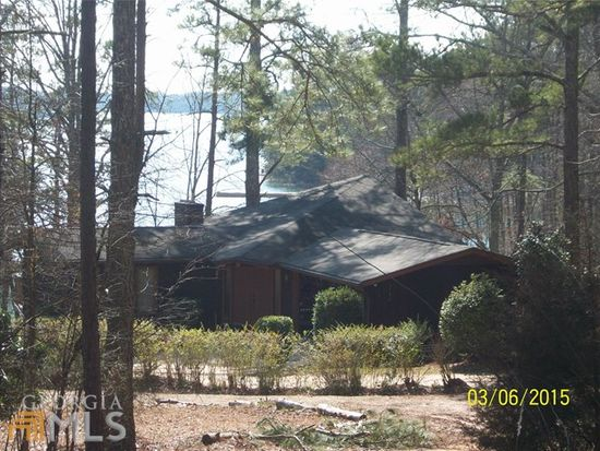 RARE FIND ON LAKE LANIER !! THIS COMFORTABLE, LOW-MAINTENANCE 2 BED 2 BATH COTTAGE SITTING ON A POINT WITH COVES ON TWO SIDES AND BEAUTIFUL VIEW HAS MASONRY FIREPLACES ON EACH LEVEL, MASTER ON MAIN, 2 CAR CARPORT AND LARGE OPEN LIVING ROOM. ENJOY THE OUTDOORS YEAR-ROUND ON THE HUGE DECK AND PORCH THAT'S PERFECT FOR SCREENING OR ENJOYING OPEN. THIS HOME IS JUST A STONE'S THROW FROM THE WATER WITH GRASS TO WATER, YEAR-ROUND VIEWS JUST MINUTES FROM AQUALAND MARINA AND PUBLIC BOAT RAMP. THERE IS A DOCK IN PLACE WITH PERMIT FOR UPGRADE TO SLIP WITH DOCK, ROOF AND SUNDECK.