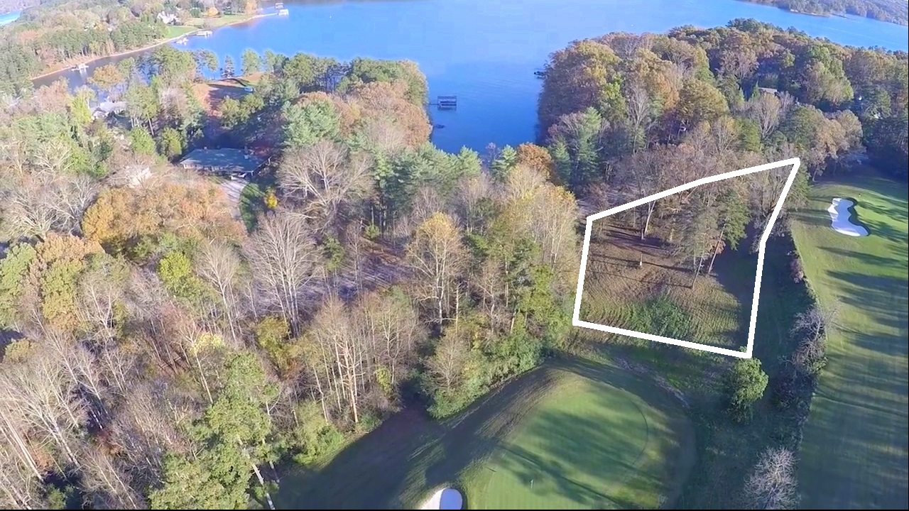 This is one of three Chattahoochee Golf Club homesites along Club Drive for sale. One of the three is already under contract. This lot fronts golf course holes 4 and 5, has US Army Corps frontage of 153 feet, and Lake Lanier views. Views also of greens 4 and 5.