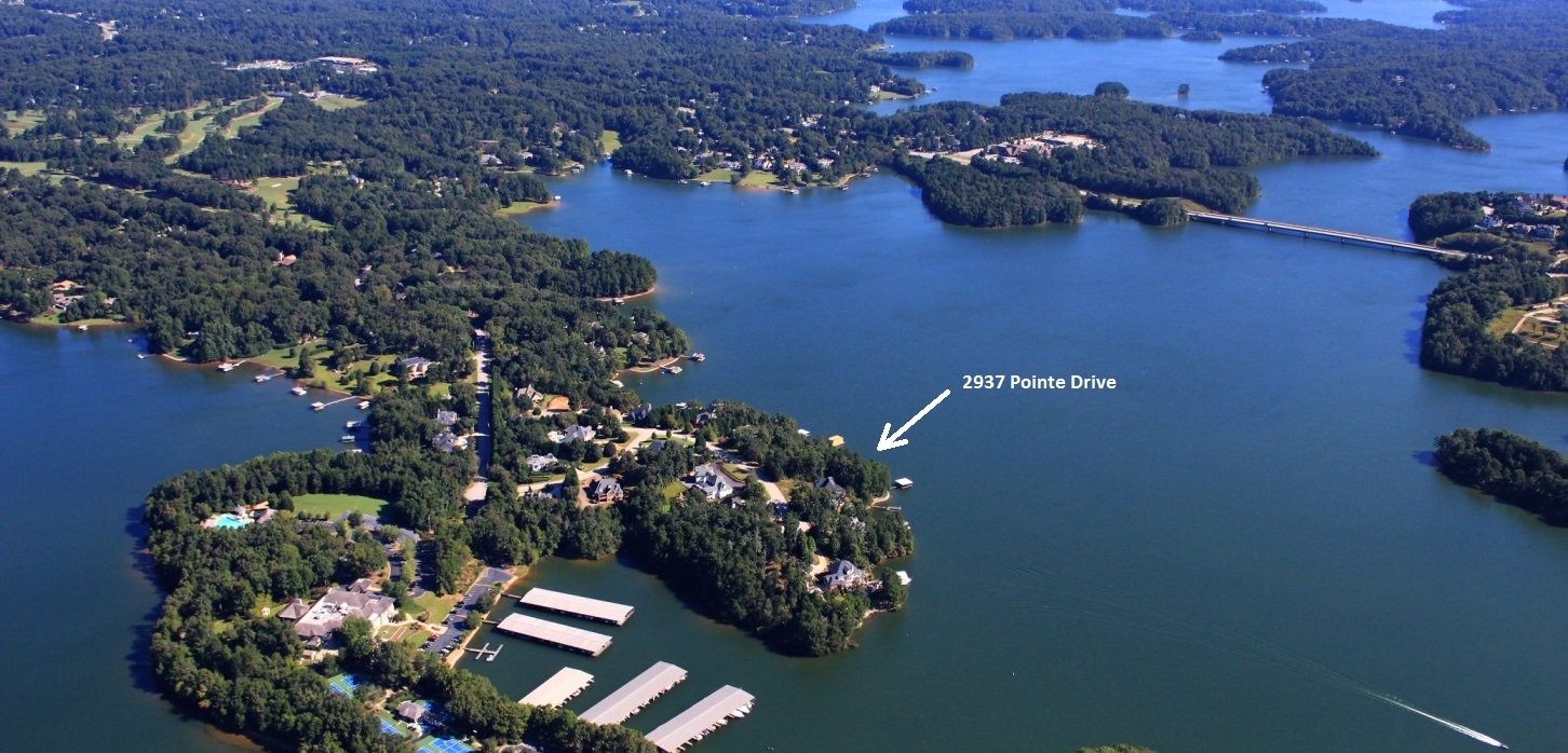 Breathtaking home site on Lake Lanier in one of the best neighborhoods on the entire lake. Panoramic unobstructed views of Lake Lanier. Property line is very near the water. Located on very deep water on the main channel of the Chattahoochee River. Double slip, covered, steel construct4ed boat dock and rip rapped shoreline are already in place. Neighborhood is located just outside of the gates of the Chattahoochee Country Club where memberships are available and just down the street from Gainesville's Chattahoochee Golf Club.