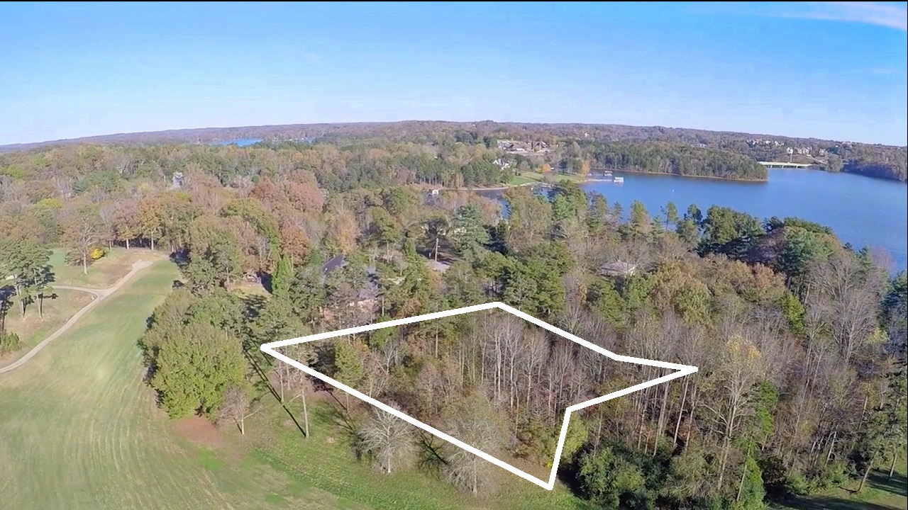 This is one of three Chattahoochee Golf Club homesites along Club Drive for sale. One of the three is already under contract. This lot fronts golf course hole # 4 and has great views of hole 4 and the #3 green. This lot also has US Army Corps frontage for 247 feet.